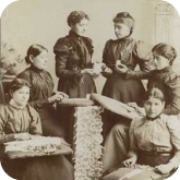 Julia Lawrence is one of the women displaying lacework in this photo
